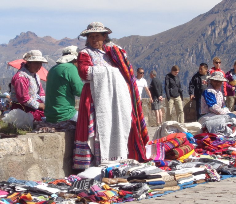 Woman selling souvenirs at Mirador Cruz del Condor